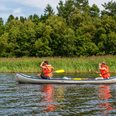 Two men in a canoe looking