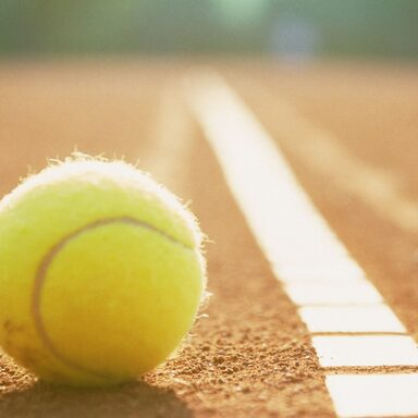 Tennis ball to corner red ground field line close up