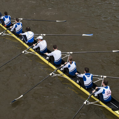 "Rowers in eight-oar rowing boat on River Thames in London, England – ""The Head of the River Race"""